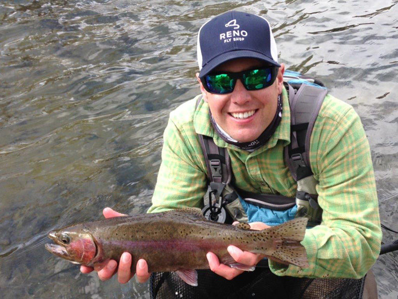 ason Mattick holds a Rainbow trout (Oncorhynchus mykiss), Truckee River. Photo: Jim Litchfield, Reno Fly Shop.