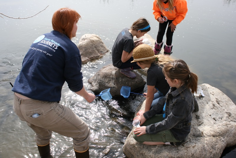 Jennifer Robinson instructs a group of students from the Sierra Expeditionary Learning School in how to capture macroinvertebrates. McCarran Ranch, Mar. 10, 2015.