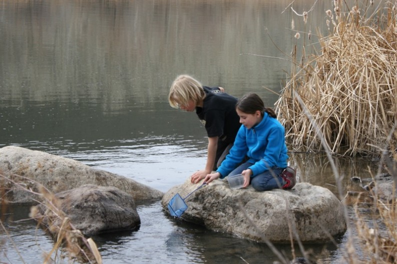 Two students from the Sierra Expeditionary Learn School explore the Truckee. Mar. 10, 2015.