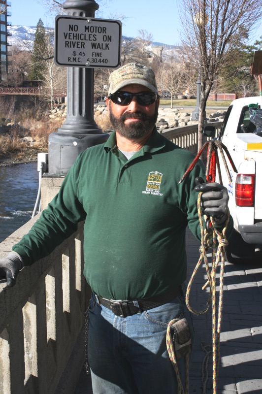 Steve Pacheco uses this red grappling hook to keep the river clean. March 5, 2015.